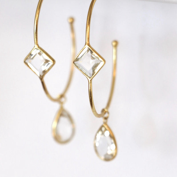 These charming hoop earrings are handmade in sterling silver and 14 carat gold plating and feature green amethyst semi-precious gemstones