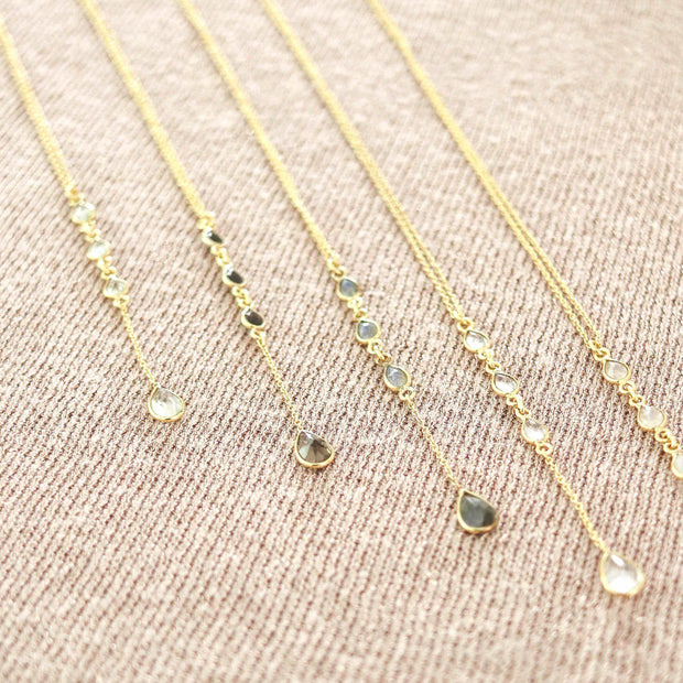 Dainty and elegant lariat necklaces feature four pear shaped gemstones in this design. Available in the semi-precious gemstone Labradorite