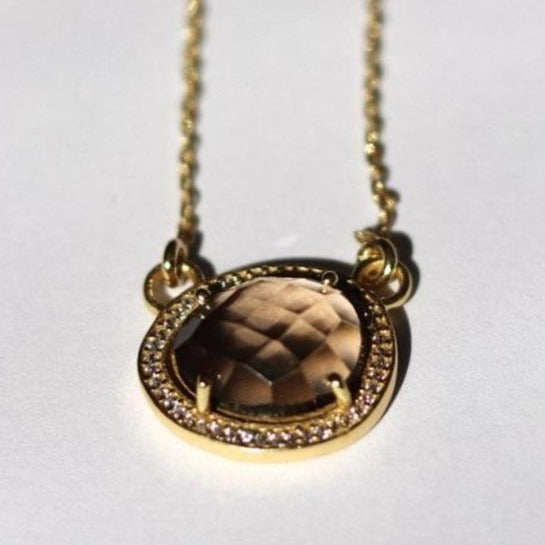 Simone Watson Jewellery - This beautiful pendant features a naturally shaped Smokey Quartz semi-precious gemstone surrounded by a halo of pave set cubic zirconias set on a dainty adjustable chain