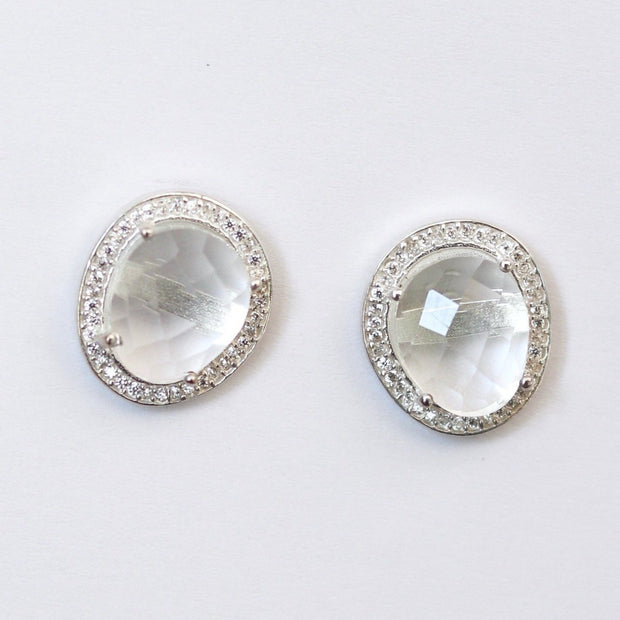 A pair of beautiful rose cut Crystal Quartz stones set in a pave halo and handmade in sterling silver - adding a subtle finishing touch to your day or night look