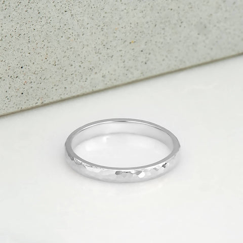 2 milimetre wide ring, polished and hammer finished, in 14 karat recycled white gold.
