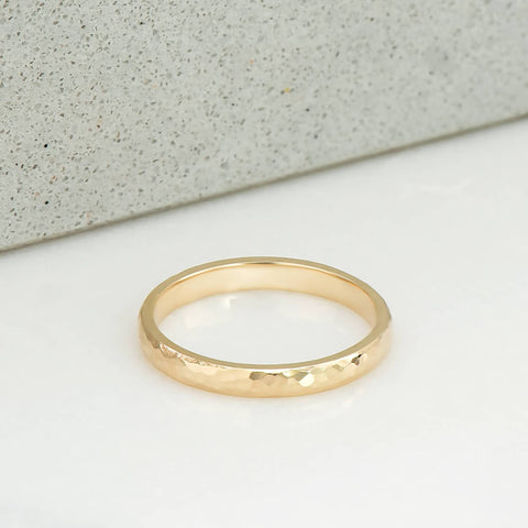2 milimetre wide ring, polished and hammer finished, in 14 karat recycled yellow gold.