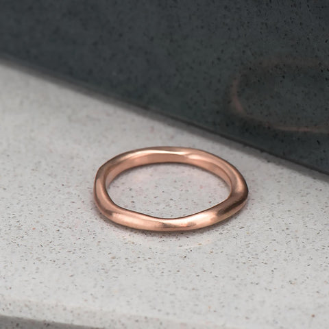 Organic, irregular shaped ring in 10 karat recycled rose gold with a satin finish.
