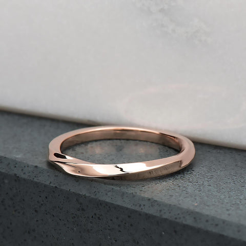 Recycled 10 karat rose gold with a half twist, the ring is 2mm in its width & thickness. It has been finished with a high mirror polish.