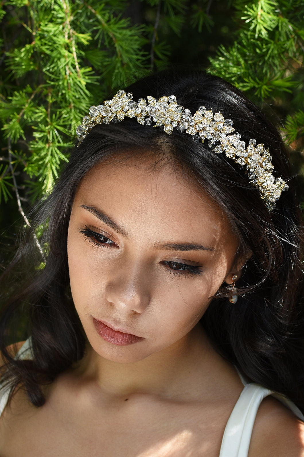 Crystal Bead Headband with Gold Parts worn by a dark haired Bride under a pine tree