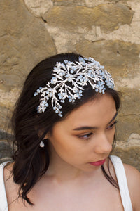 Wide Bridal Headband in Silver with white opal Swarovski  beads worn by a bride