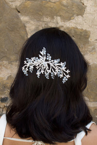 Silver Bridal Side Comb with Swarovski White Opal beads shown on a popular bridal hairstyle