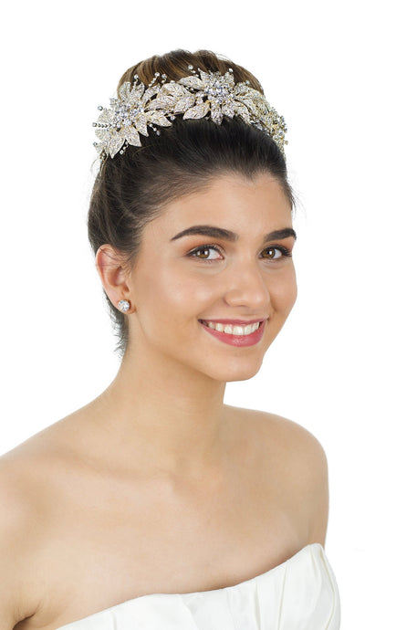 Bridal Crown in Pale Gold and large flowers worn by smiling bride