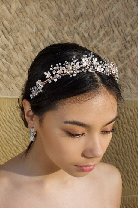 Low Pale Rose Gold Tiara with pearls made with five points worn by a dark hair bride