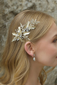 Blonde model wearing pale gold bridal side comb with pear shape gold earring