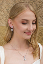 Load image into Gallery viewer, Blonde Bridal Model wearing a short pear shape drop earring with a sandstone backdrop