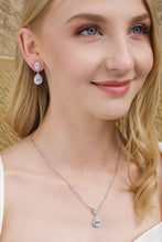 Load image into Gallery viewer, Blonde Model earring a matching pear shape earring and pendant necklace with a sandstone backdrop