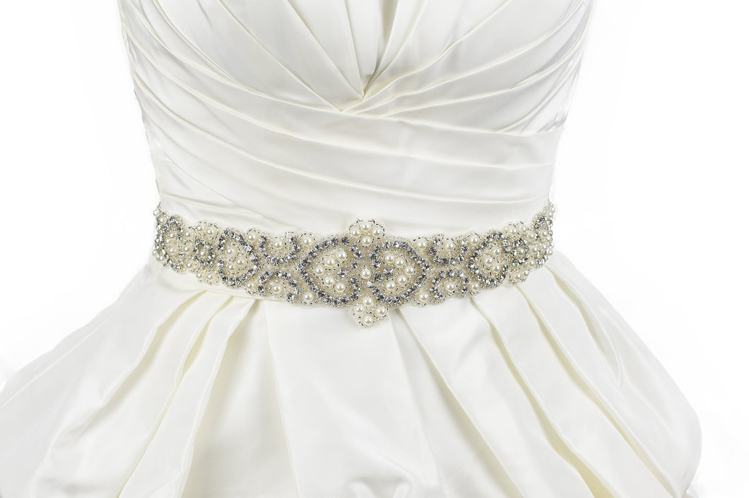 Pearls and Crystals Bridal belt on ivory satin ribbon worn on an ivory satin bridal gown