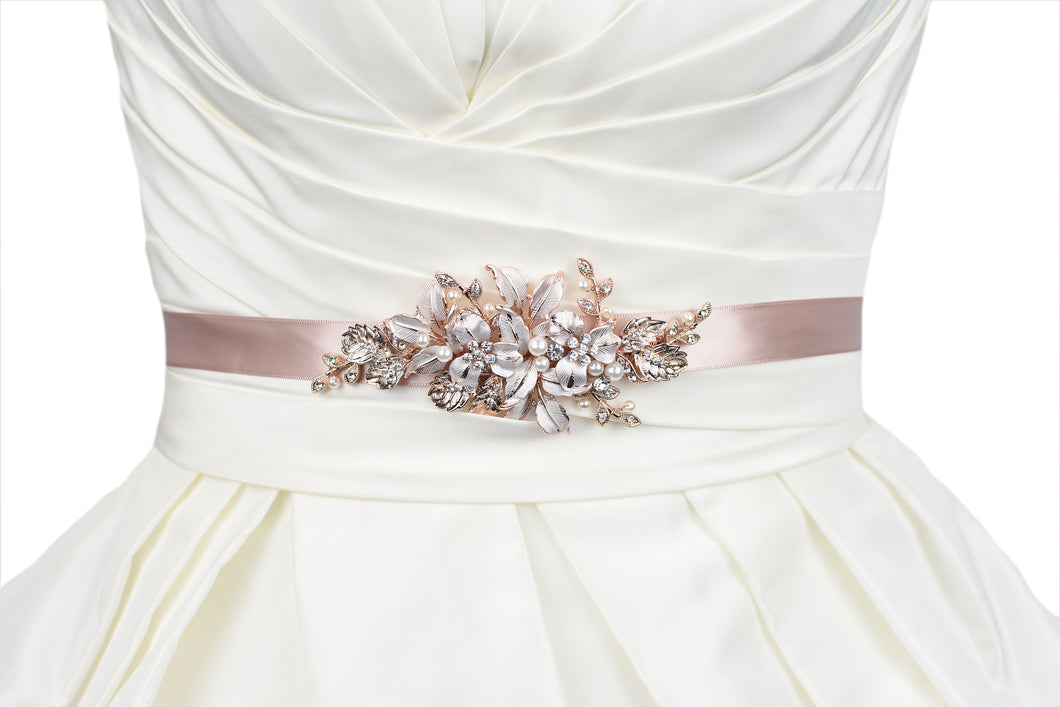 Pale Rose Gold Bridal Belt with leaves and flowers on matching dusty pink ribbon worn on an ivory bridal gown