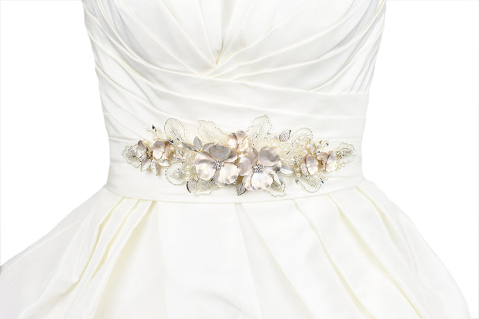 Wide Belt on an ivory Bridal Gown with large pale gold flowers and a border of lace leaves