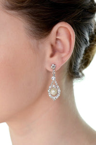 A models' ear wears a pearl drop earring against a white background