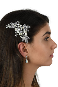 Silver Leaves and freshwater pearls side comb worn by a dark hair model on the side of the head