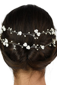 Close up of a 2 row silver vine on the back of a dark hair model with a white backdrop