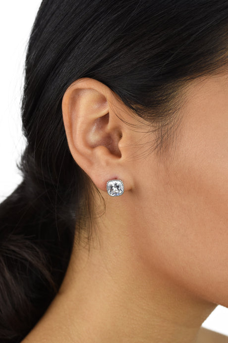 Square shape crystal stud earring with rounded edges worn in the ear of a model