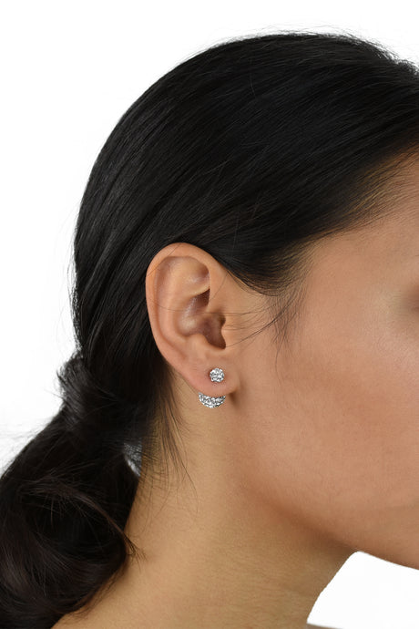 Dark hair model with pony tail hairstyle wears a double crystal ball earring