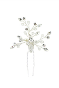 A small Bridal Hairpin with Swarovski White Opal and pearl in silver on a white backdrop