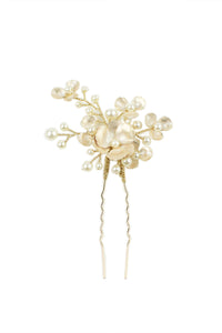 Small pearl and gold hairpin on a bright white background