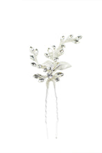 Load image into Gallery viewer, A silver hairpin with crystals shown on a white background