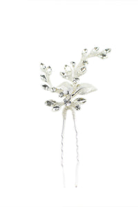A silver hairpin with crystals shown on a white background