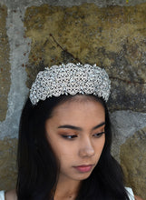 Load image into Gallery viewer, Very high Bridal Tiara with hundreds of tiny crystals worn by a dark hair bride with a stone wall backdrop