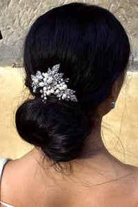 Dark Silver leaves and freshwater pearl  Bridal Comb worn by a Bride in front of a stone wall
