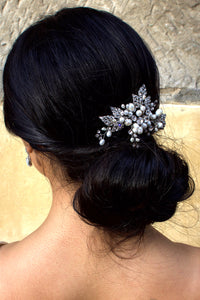 Rhodium and freshwater pearls Bridal comb worn at the back of the head of a dark hair model