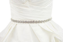 Load image into Gallery viewer, A narrow crystal bridal belt with rings of crystals around the pearls is worn on an ivory bridal gown