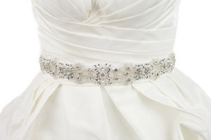 Crystals and beads Bridal Sash worn on organza ribbon on an ivory bridal gown with white background