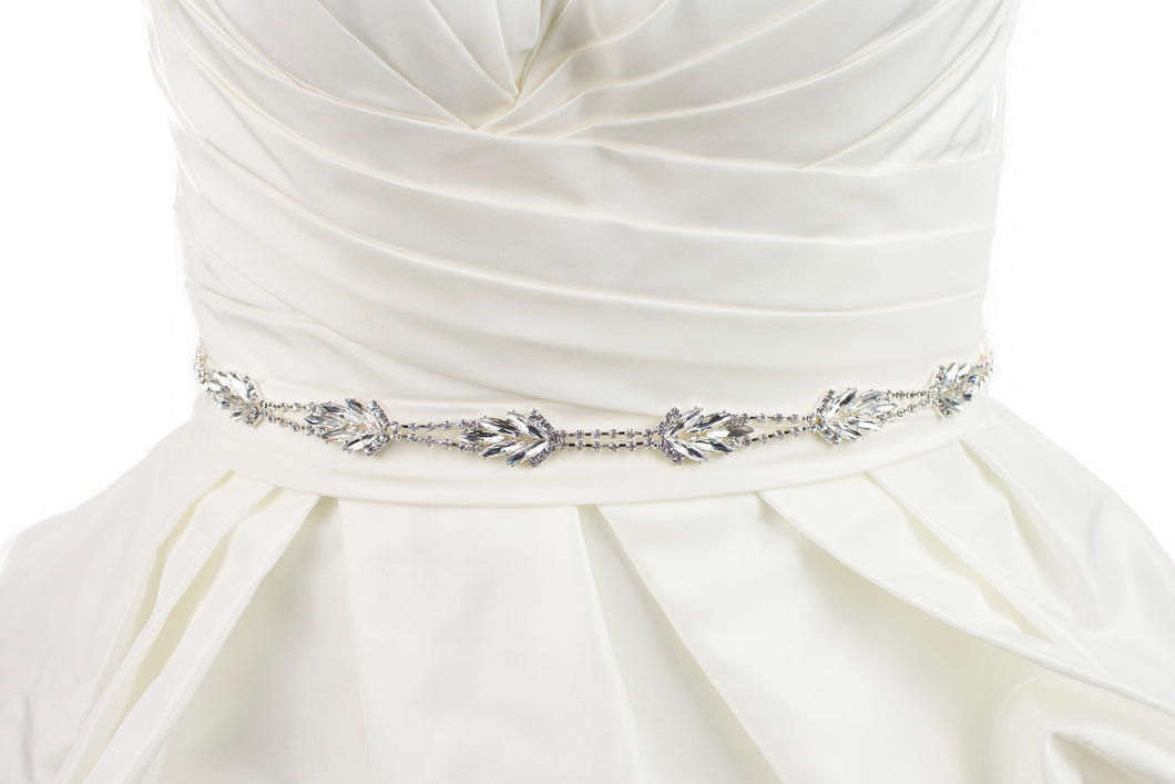 A thin silver Bridal Belt with long narrow stones worn on an Ivory Bridal Gown