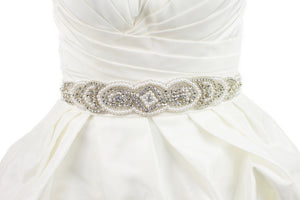 Pearl Bridal Belt Abigail shown on ivory satin ribbon on a plain bridal gown.