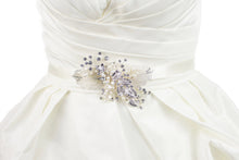 Load image into Gallery viewer, Silver filigree leaves and real pearls are on a Bridal Belt made on ivory satin and worn on an ivory satin gown