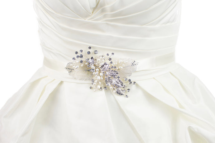 Silver filigree leaves and real pearls are on a Bridal Belt made on ivory satin and worn on an ivory satin gown