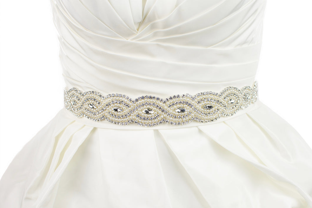 Bridal Sash with rows of pearls and stones worn on a bridal gown in Ivory colour