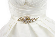 Load image into Gallery viewer, Pale Gold leaves and flowers motif on an ivory satin ribbon worn on an ivory bridal gown.