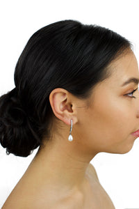 Pearl drop bridal earring in silver worn by a dark hair model