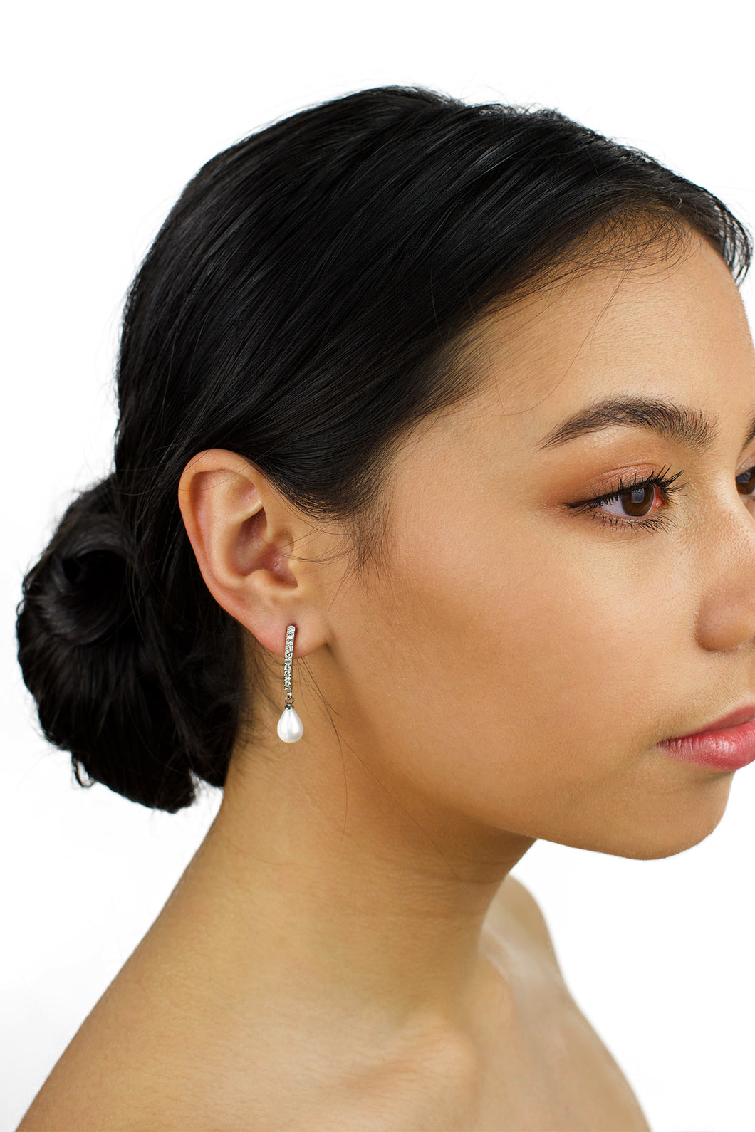 long pearl earring worn by a dark hair bridal model