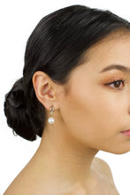 Load image into Gallery viewer, Small Gold and pearl drop earring worn by a dark haired bridal model