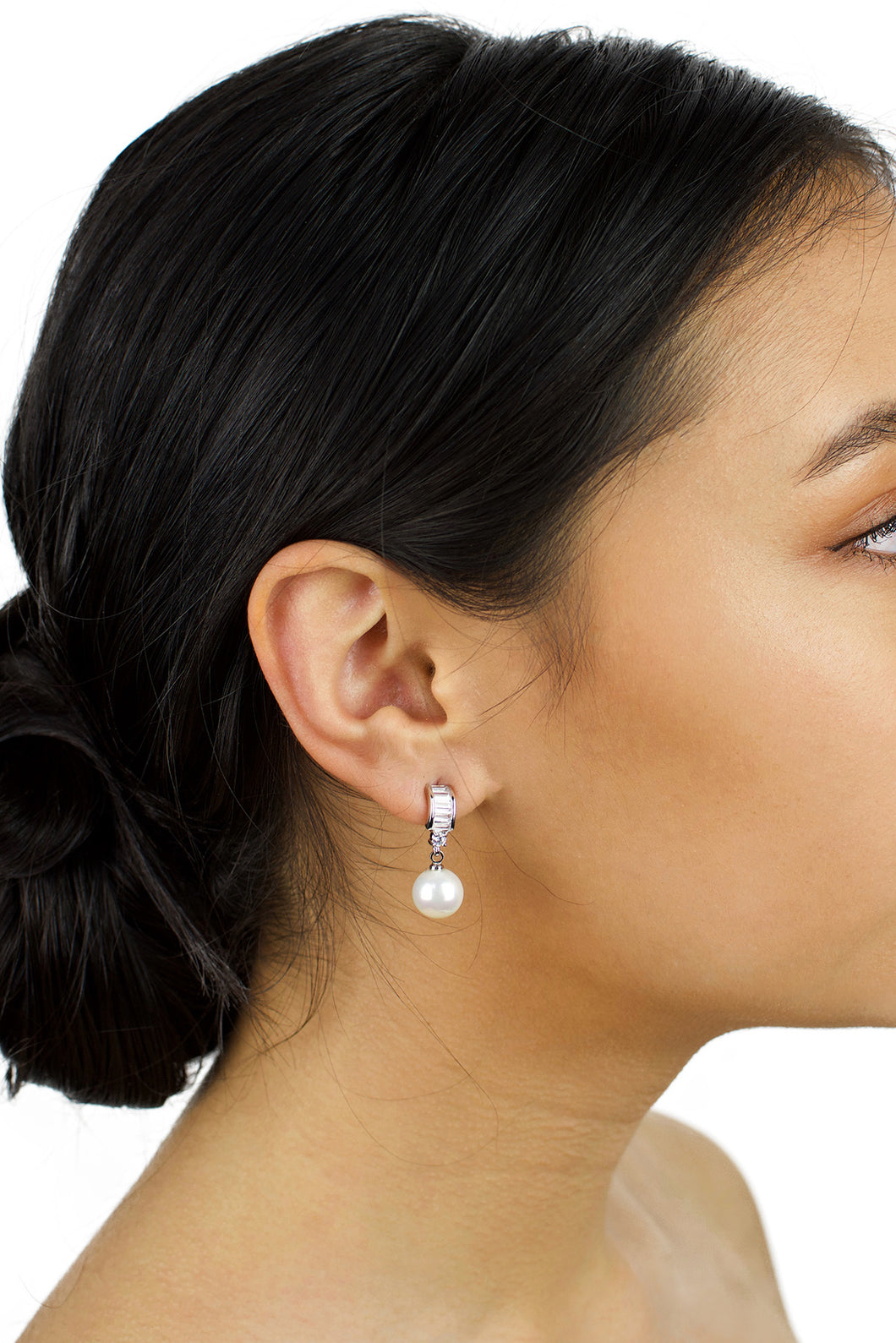 Small pearl earring with clear stones worn by a dark haired bridal model