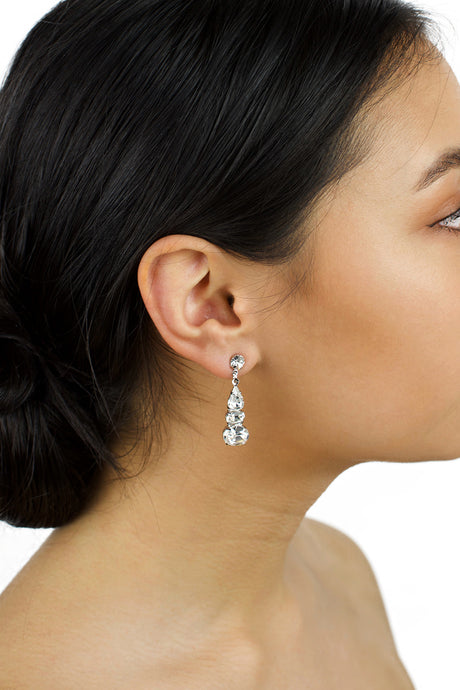 Dark hair model wearing a medium length drop earring with Swarovski Stones