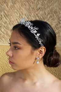 Low Silver Bridal Tiara with leaves and pearls worn by dark hair model