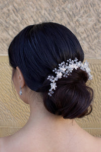 Clear crystal and silver short hair vine worn by a dark haired bride
