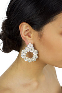 Soft Silver Flowers Bridal Earring worn by a bride with up hairdo