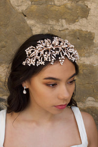 Rose Gold Headband with coral colour beads  on a dark haired bride