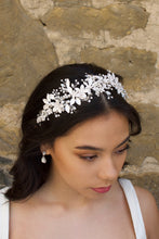 Load image into Gallery viewer, Black haired model wears a silver leaves headband with a wall backdrop