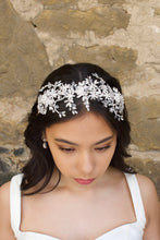 Load image into Gallery viewer, Silver and crystal headband worn by a bridal model at the front of her head